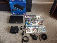 500 GB super-slim PS3- boxed with remotes and games