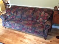 Couch and chair with 2 matching cushions.