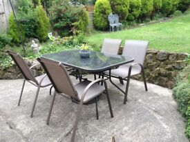 Garden table and 4 chairs.