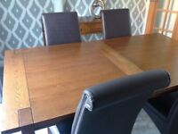 Marks and Spencer Sonoma oak extending dining table and four brown leather chairs