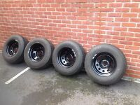 4x4 wheels and tyres . Black steel modular rims brand new with nexen a/t tyres