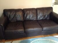 Brown leather three seat sofa