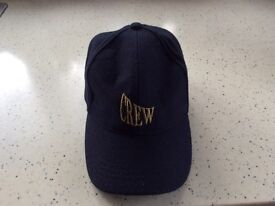 Two CREW navy blue caps