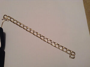13 GRAMS OF 10 K SOLID GOLD MANS BRACELET / WITH A NEW