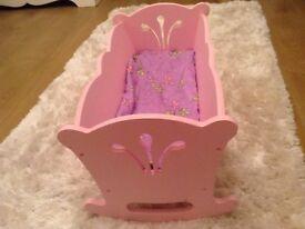 Lovely pink wooden dolls crib