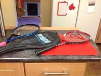 Pair of tennis rackets one is graphite