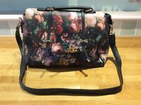 Floral handbag satchel style with black spotty silky lining
