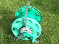 Garden hose with reel.