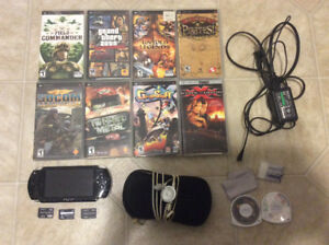 Sony PSP with 7 games and more