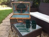 Green and tan picnic basket