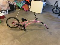 Adams foldable pink Trail-a-Bike with 2 hitches