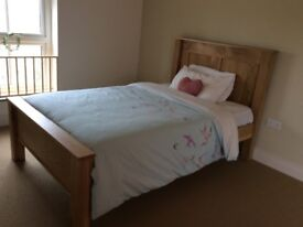 Small double solid oak bed - without mattress