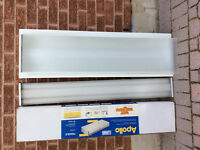 Fluorescent recessed light fixtures and tubes