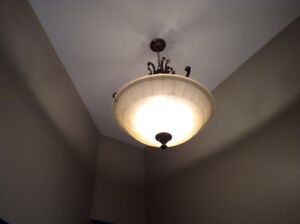 Entrance chandelier with matching dinning or living room light