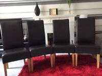 Brown leather dining chairs x 4 from Costco. Good condition.