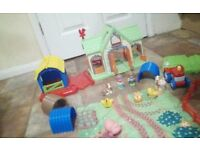 Happyland farm includes 2 tractors, 2 buildings the farm house makes sounds, animals/character