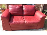 Red leather 2 seater sofa