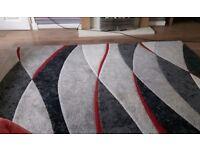 Large grey red and dark grey rug