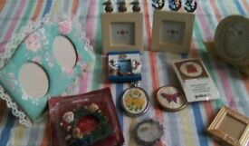 Eleven different small photo frames including seaside design, Xmas, snail, round frames.