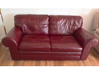 Quality, burgundy leather metal-framed sofa bed. 3 seat / sleeps 2 adults. Exceptional condition