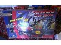 Artin Loop Shoot quadruple electric race track with twin cars. scalextric.