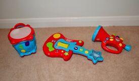 Chad Valley Music Kidz toy instruments (drum, guitar, and trumpet)