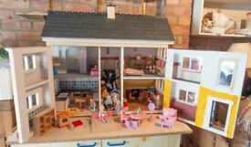 Delightful old fashioned doll house