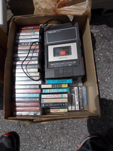 100+ cassettes and a vintage player.
