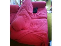 Red IKEA sofa with brand new unused cover. 2 Seater (180 cm wide)