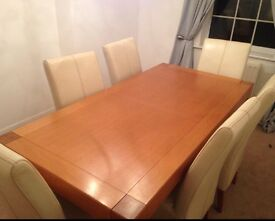 Solid oak table and 6 leather cream chairs... Amazing condition!