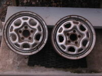 Two 13 inch five stud rims