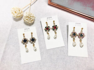 Selling fancy drop earrings for $12 each