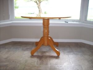 Solid wood round drop leaf kitchen table