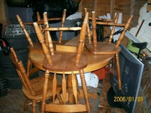 A Round Table and 4 chairs suitable for a Cabin