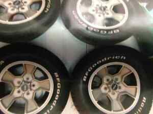 FOR SALE T/A RADIALS AND RIMS