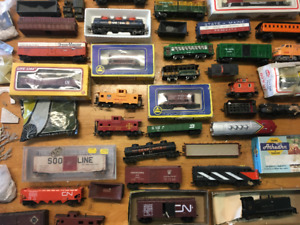 Large assortment of HO scale trains, track, accessories