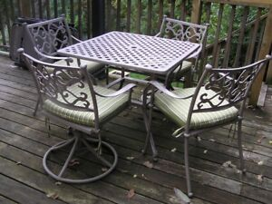 Cast Iron  Outdoor table & four chairs & Four pillows