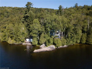 Privacy, Acreage and Waterfront on Sand Lake