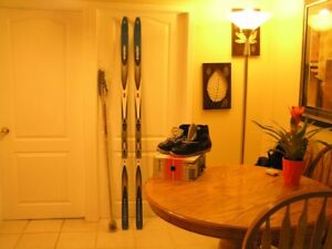 NEVER USED LADIES CROSS COUNTRY SKI'S, POLES & BOOTS