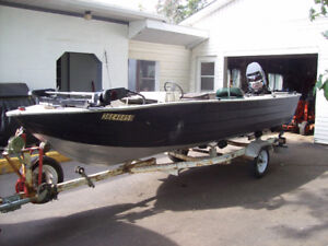 16 ft aluminum fishing boat with 85 hp merc and trailer