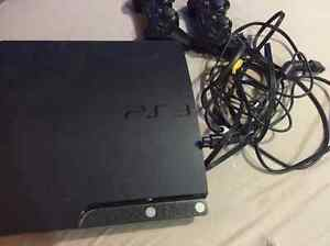 Playstation 3 Slim with 10 games and 2 controllers