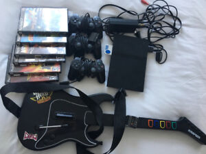 PlayStation 2 Slim, controllers, games, guitar. $60 OBO