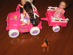 Three little dolls in a jeep and trailer  - quick sale $5.00