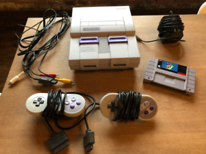 Super Nintendo Console (SNES) + Super Mario World + Controllers
