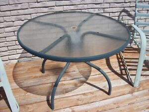Outdoor tempered glass table