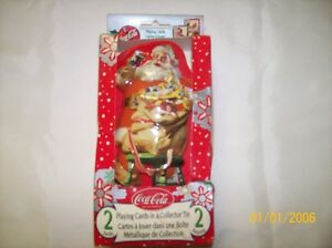 Chrismas Tin with two decks of  Coca-Cola christmas cards.