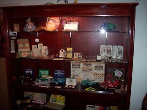 Large wooden display cabinet to display tour collectibles