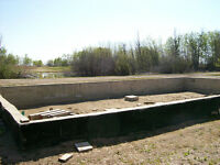 FULLY SERVICED LOT WITH FOUNDATION POURED