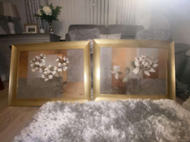 Floral canvas with gold textured framing.