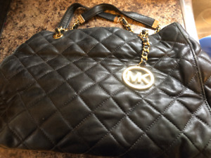Black quilted Michael Kors purse with gold chain. Paid $300.